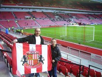 Holding up a Sunderland flag