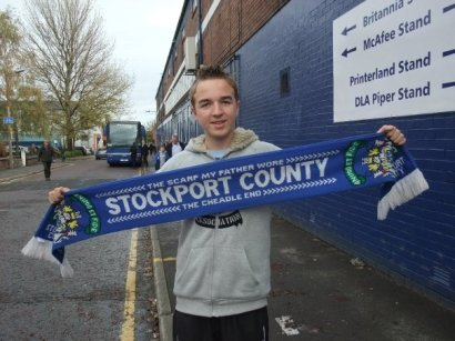 I hold up a Stockport scarf