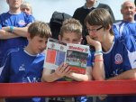 Some fans read the programme