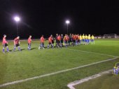 The players shake hands prior to kick off