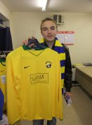 I hold up a Garforth Town shirt in the club shop