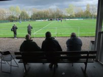 3 Louth Town fans watch the action