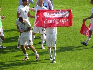 Celebrating promotion on the Kassam pitch