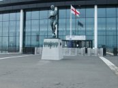 The England flag waves behind Moore's statue