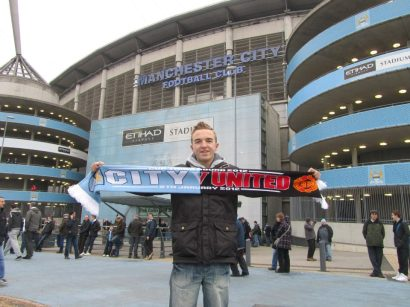 Holding up my scarf ahead of the Manchester derby