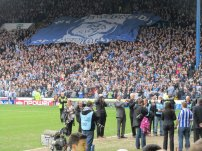 The Sheffield Wednesday flag travels up the Kop