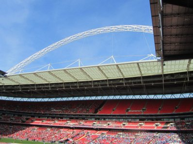 Looking up at the beautiful blue sky and the Wembley arch