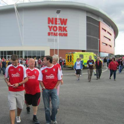 Three Millers fans discuss the game on their way home