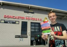 I hold up the matchday programme outside the ground