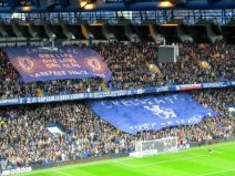 The Chelsea fans show off their flags while showing their support for Roberto Di Matteo