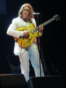 A white suited John Lennon