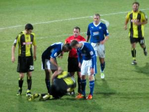 Jack Lester gets frustrated as a Burton player hits the floor