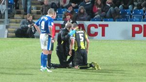 Zander Diamond receives treatment after the incident that saw Lester sent off
