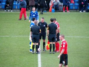 The two captains shake hands before kick off