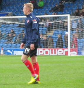 Former Chesterfield youth player Jordan Burrow warms up for Morecambe