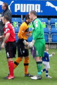 The two goalkeepers, Tommy Lee and Barry Roche, shake hands