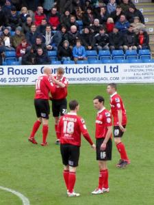 The Morecambe players prepare for kick off