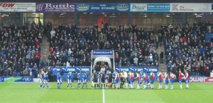 The two teams line up before kick off