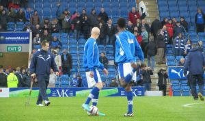 Chesterfield's Danny Whitaker and Neal Trotman warm up