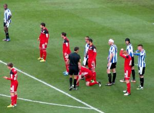 The game is held up while a City player ties his shoelaces