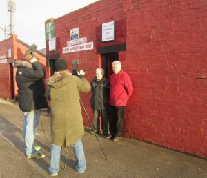Barnsley supporters are interviewed before the game