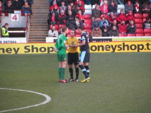 The referee tells the captains to calm their players down