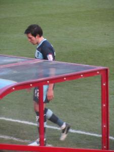 Brian Stock leaves the pitch after receiving a second yellow card
