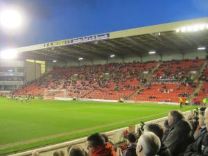 The Barnsley fans watch the final few minutes of the game