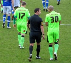 Carlisle speaks to referee Stuart Atwell