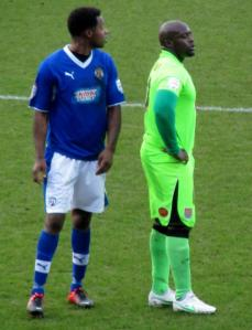 Neal Trotman keeps a close eye on Ade Akinfenwa