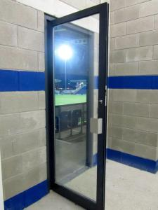 The floodlight shines through a door