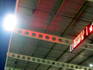 Looking up towards the scoreboard and floodlight
