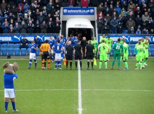 The two teams make their way on to the pitch