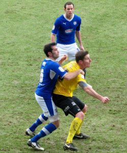 Sam Hird and Barry Corr battle for possession