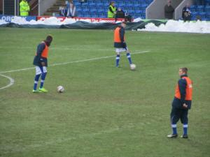 The substitutes warm up at half time