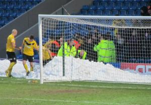 The Southend players celebrate in the snow