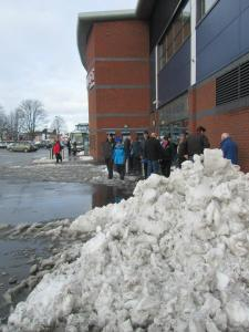 Queues for tickets alongside the large piles of snow