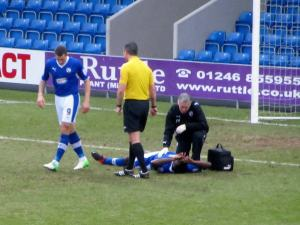 Neal Trotman receives treatment early in the game