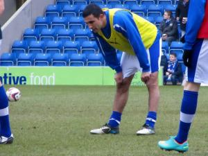 Jack Lester warms up with the substitutes after rumours about his future during the week