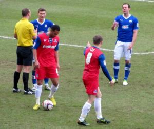 The referee awards a free kick to Gillingham