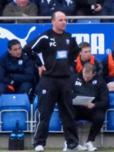 Paul Cook watches the action