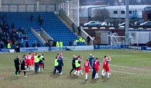 The Gillingham players applaud their travelling supporters