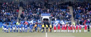 The two teams line up prior to kick off