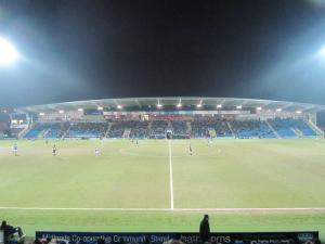 The floodlights shine over the stadium
