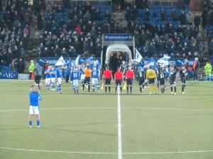 The players line up prior to kick off