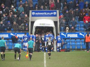 The players head to the dressing rooms with the score 0-0