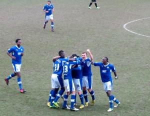 The Chesterfield players celebrate as Jay O'Shea opens the scoring