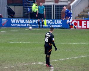 Danny Whitaker takes a late corner
