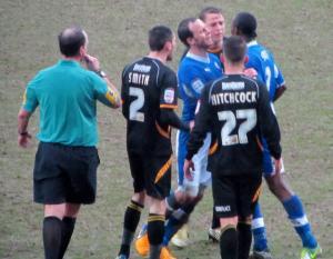 Sam Togwell holds back an angry Nathan Smith