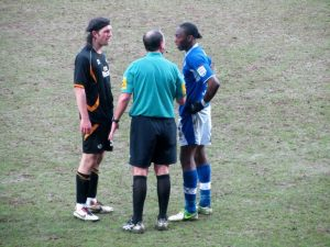 The referee speaks to John-Joe O'Toole and Nathan Smith after the incident